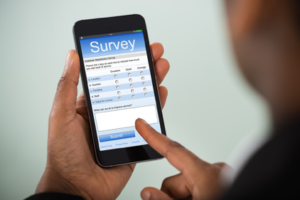 person taking an online survey using a smartphone
